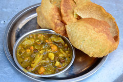 Puri Sabji. Puri and Potato-mix curry served in a plate Stock Photography