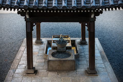 Purification fountain at shrine in Kyoto, Japan Stock Photography