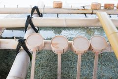 Free Purification Fountain With Wooden Ladles In Shitennoji Temple Royalty Free Stock Photography - 100411787