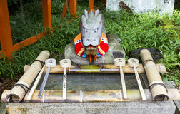 Purification ladles and a dragon statue in a shinto shrine in Ja Stock Photography