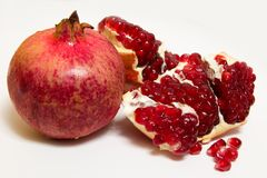 Purified pomegranate fruit on a white background. Isolate Royalty Free Stock Photos