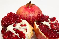 Purified pomegranate fruit on a white background. Purified pomegranate t on a white background - isolate Royalty Free Stock Photo