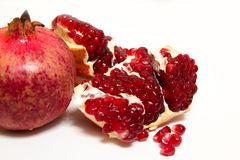 Purified pomegranate fruit on a white background. Purified pomegranate t on a white background - isolate Stock Photography