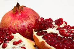 Purified pomegranate fruit on a white background. Purified pomegranate t on a white background - isolate Stock Images
