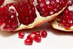 Purified pomegranate fruit on a white background. Purified pomegranate t on a white background - isolate Royalty Free Stock Images