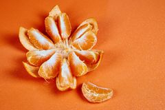 purified Mandarin on red orange background stock photo