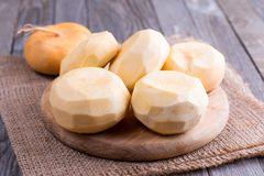 Purified turnips on a wooden table Royalty Free Stock Photography