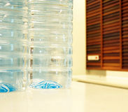 Purified water bottle on white table Royalty Free Stock Photography