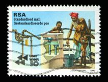 Purifying water, 50th Anniversary of CSIR serie, circa 1995. MOSCOW, RUSSIA - MAY 13, 2018: A stamp printed in South Africa shows Purifying water, 50th stock photos