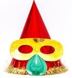 purim 小丑的与一个滑稽的面具的盖帽红色 库存照片