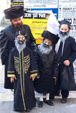 Purim celebration in Bnei Brak. BNEI BRAK - MARCH 04: The Jewish Purim celebration in Bnei Brak. An orthodox religious Jews Family in fancy clothes. March 04 Stock Photography