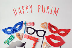 Purim celebration concept with carnival mask and photo props on white background. Top view from above Stock Images