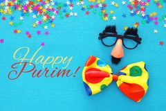 Purim celebration concept & x28;jewish carnival holiday& x29; with funny mustache glasses. Top view stock image