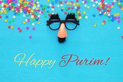 Purim celebration concept & x28;jewish carnival holiday& x29; with funny mustache glasses. Top view royalty free stock photos