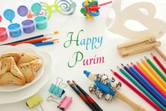 Purim celebration concept & x28;jewish carnival holiday& x29;. Mask coloring fun artwork leisure and painting accessories. Purim celebration concept & Royalty Free Stock Photos