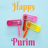 Purim celebration concept jewish carnival holiday. Top view of noise maker traditional toy. Purim celebration concept jewish carnival holiday. Top view of noise stock photos
