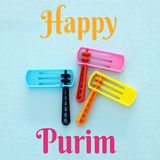 Purim celebration concept jewish carnival holiday. Top view of noise maker traditional toy. Purim celebration concept jewish carnival holiday. Top view of noise royalty free stock photo