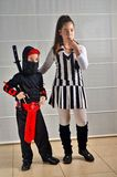 Purim (Halloween): siblings dressed up Stock Photos