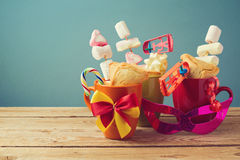 Purim holiday gifts with cookies and candy in cups Stock Photography