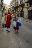 Purim 2016 in Jerusalem. JERUSALEM, ISR - FEB 25, 2016: Street scene of people carrying mishloach manot (portions to the poor), a Jewish Holyday Purim tradition Stock Photo