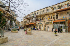 Purim 2016 in Jerusalem. JERUSALEM, ISRAEL - FEBRUARY 25, 2016: Street scene of the Jewish Holyday Purim, with locals, some wearing costumes, in Batei Ungarin Royalty Free Stock Images
