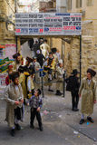 Purim 2016 in Jerusalem. JERUSALEM, ISRAEL - FEBRUARY 25, 2016: Street scene of the Jewish Holyday Purim, with locals, some wearing costumes, in the ultra Royalty Free Stock Image