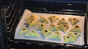 Purim Jewish Holiday food - Hamentashen, Ozen Haman. Backed Hamentashen, Ozen Haman, Purim cookies for the Jewish holiday Purim stock video