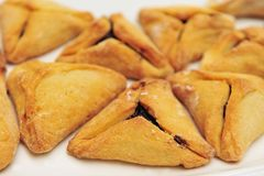 Purim Jewish Pastry Hamantashen. A hamantash is a pastry in Ashkenazi Jewish cuisine, traditionally eaten during the Jewish holiday of Purim Royalty Free Stock Photo