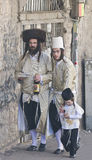 Purim in Mea Shearim. JERUSALEM - MARS 09 : Ultra Orthodox family during Purim in Mea Shearim Jerusalem on Mars 09 2012 , Purim is a Jewish holiday celebrates Stock Image