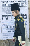 Purim in Mea Shearim. JERUSALEM - MARS 09 : Ultra Orthodox costumed boy during Purim in Mea Shearim Jerusalem on Mars 09 2012 , Purim is a Jewish holiday Stock Photography