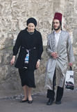 Purim in Mea Shearim. JERUSALEM - MARS 09 : Ultra Orthodox couple during Purim in Mea Shearim Jerusalem on Mars 09 2012 , Purim is a Jewish holiday celebrates Stock Photography