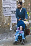 Purim in Mea Shearim. JERUSALEM - MARS 08 : Ultra Orthodox family during Purim in Mea Shearim Jerusalem on Mars 09 2012 , Purim is a Jewish holiday celebrates Royalty Free Stock Photos