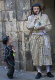 Purim in Mea Shearim. JERUSALEM - MARS 09 : Ultra Orthodox man holding Mishloach Manot during Purim in Mea Shearim Jerusalem on Mars 09 2012 , Mishloach Manot is Stock Image