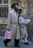 Purim in Mea Shearim. JERUSALEM - MARS 09 : Ultra Orthodox boy holding Mishloach Manot during Purim in Mea Shearim Jerusalem on Mars 09 2012 , Mishloach Manot is Royalty Free Stock Image