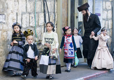 Purim in Mea Shearim. JERUSALEM - MARS 09 : Ultra Orthodox family during Purim in Mea Shearim Jerusalem on Mars 09 2012 , Purim is a Jewish holiday celebrates Stock Photos