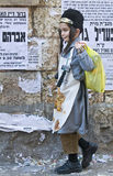 Purim in Mea Shearim. JERUSALEM - MARS 09 : Ultra Orthodox costumed boy during Purim in Mea Shearim Jerusalem on Mars 09 2012 , Purim is a Jewish holiday Stock Photo