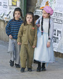 Purim in Mea Shearim. JERUSALEM - MARS 09 : Ultra Orthodox costumed children during Purim in Mea Shearim Jerusalem on Mars 09 2012 , Purim is a Jewish holiday Stock Photo