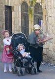 Purim in Mea Shearim. JERUSALEM - MARS 09 : Ultra Orthodox family during Purim in Mea Shearim Jerusalem on Mars 09 2012 , Purim is a Jewish holiday celebrates Royalty Free Stock Image