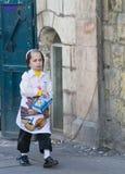 Purim in Mea Shearim. JERUSALEM - MARS 09 : Ultra Orthodox costumed boy during Purim in Mea Shearim Jerusalem on Mars 09 2012 , Purim is a Jewish holiday royalty free stock photo