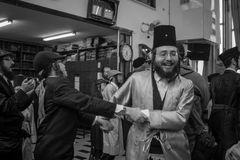 Purim 2017 in  Mea Shearim, Jerusalem. JERUSALEM, ISRAEL - MARCH 13, 2017: Jewish men attend and dance, as part of a celebration of the Jewish Holyday Purim, in Stock Photo