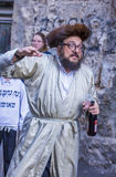 Purim in Mea Shearim. JERUSALEM - MARCH 13 : Ultra Orthodox drunk man during Purim in Mea Shearim Jerusalem on March 13 2017 , Purim is a Jewish holiday Stock Photo