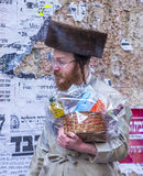 Purim in Mea Shearim. JERUSALEM - MARCH 13 : Ultra Orthodox man holding Mishloach Manot during Purim in Mea Shearim Jerusalem on March 13 2017 , Mishloach Manot Royalty Free Stock Photos