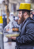 Purim in Mea Shearim. JERUSALEM - MARCH 13 : Ultra Orthodox man holding Mishloach Manot during Purim in Mea Shearim Jerusalem on March 13 2017 , Mishloach Manot Stock Image