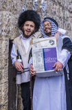 Purim in Mea Shearim. JERUSALEM - MARCH 13 : Ultra Orthodox men holding Mishloach Manot during Purim in Mea Shearim Jerusalem on March 13 2017 , Mishloach Manot Stock Photo