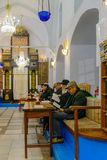 Purim 2018 in the old Abuhav synagogue, Safed Tzfat. SAFED, ISRAEL - FEB 28, 2018: Traditional Purim Jewish Holiday in the old Abuhav synagogue with prayers Stock Images