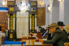 Purim 2018 in the old Abuhav synagogue, Safed Tzfat. SAFED, ISRAEL - FEB 28, 2018: Traditional Purim Jewish Holiday in the old Abuhav synagogue with prayers Stock Photography