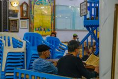 Purim 2018 in the old Abuhav synagogue, Safed Tzfat. SAFED, ISRAEL - FEB 28, 2018: Traditional Purim Jewish Holiday in the old Abuhav synagogue with prayers Stock Photo