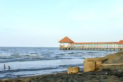 Purin Beach Pier in Tegal regency, Indonesia. Purin Beach Pier in Tegal regency, Indonesia, has beautiful sea, moderate waves and gentle beach breeze stock images