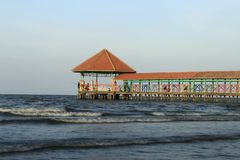 Purin Beach Pier in Tegal regency, Indonesia. Purin Beach Pier in Tegal regency, Indonesia, has beautiful sea, moderate waves and gentle beach breeze royalty free stock photo