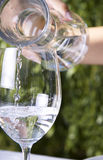 Puring water into a glass Stock Photo